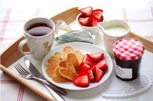 Heart shaped pancakes, strawberry, coffee,
