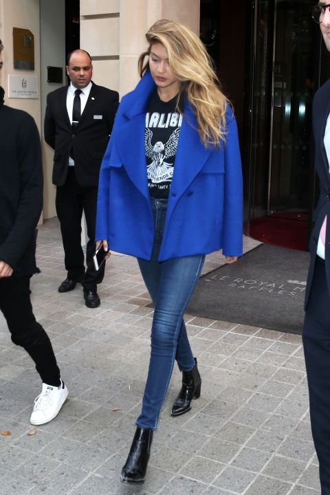 Gigi Hadid accentuates her mile-long legs in a classic pair of Parker Smith skinny jeans, with a rocker tee and vibrant coat.