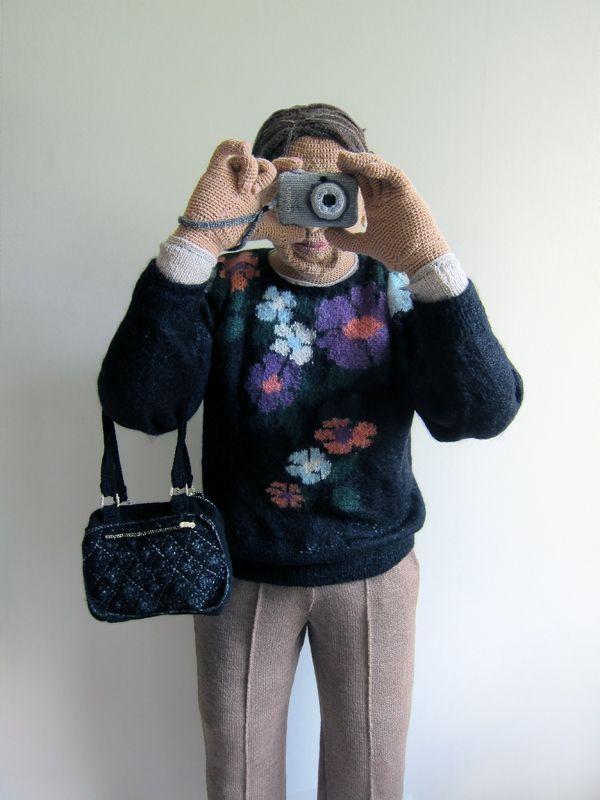 Sirpa life size woman with camera by Liisa Hietanen