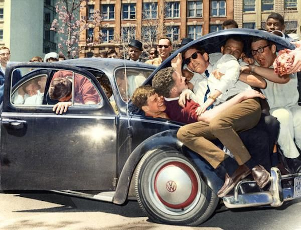 College students pile into a Volkswagen Beetle, (c. 1965)  |  Amazing images from the past that have been colored and restored (29 Photos)