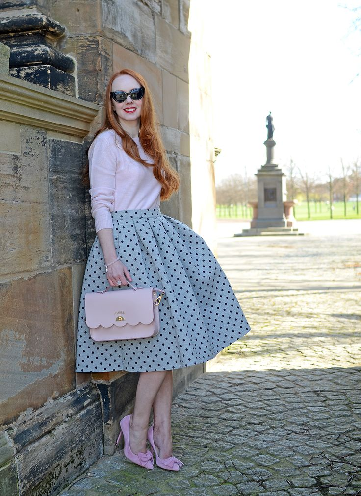 50s-inspired grey polka dot skirt with pink sweater