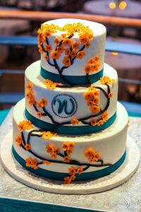 The Erica Ercream With Teal Ribbon And Orange Blossoms Wedding Cakes