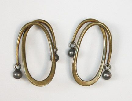 "Art Smith, American. Earrings, c. 1950's. Silver and brass. Stamped ""Art Smith"" 2"" high x 1 1/4"" wide. One of the leading modernist jewelers of the mid-twentieth century, Smith trained at Cooper Union. Inspired by surrealism, biomorphicism, and primitivism, Art Smith's jewelry is dynamic in its size and form. Although sometimes massive in scale, his jewelry remains lightweight and wearable. See ""From the Village to Vogue: The Modernist Jewelry of Art Smith"". Price on request."