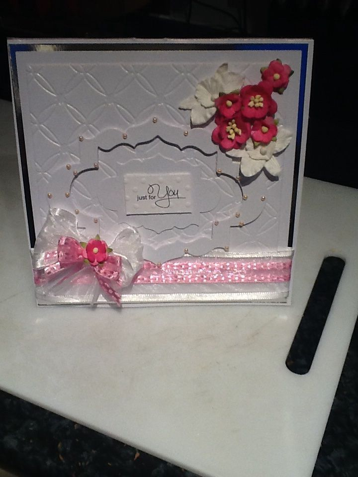 I have used grand square dies to create this card. The ribbon is from C & C and the flowers are from Wild Orchid