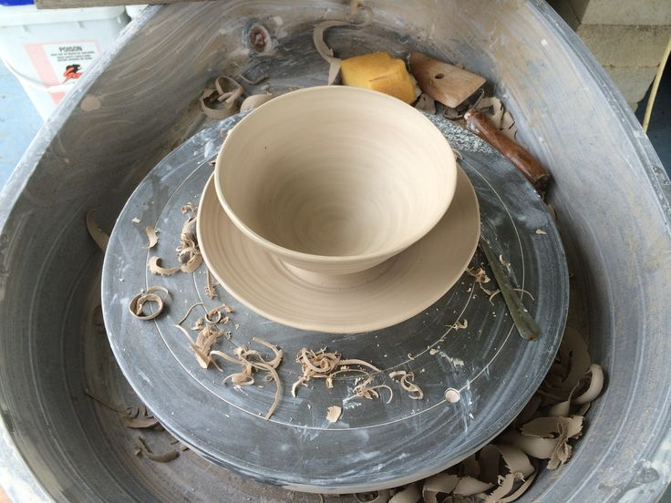 Hand thrown double bowl.  Keeping ants from cat food
