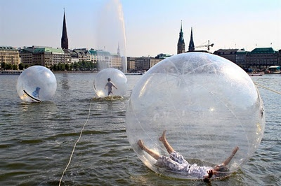 Water Bubbles in on the Alster River in Hamburg... like giant hamster balls!  I'd love to take a daily spin in one of these :-D