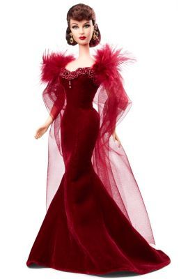 Gone With The Wind™ Scarlett O'Hara™ Truly stunning, this Scarlett O'Hara™  portrait doll is sculpted in Vivien Leigh's likeness and wears a recreation of the scandalous dress worn to Ashley Wilkes'™ birthday party. The dress features jewelled trim, dramatic layers of sheer tulle and soft feathers across the shoulders. Finishing touches include drop earrings and garnet lips.