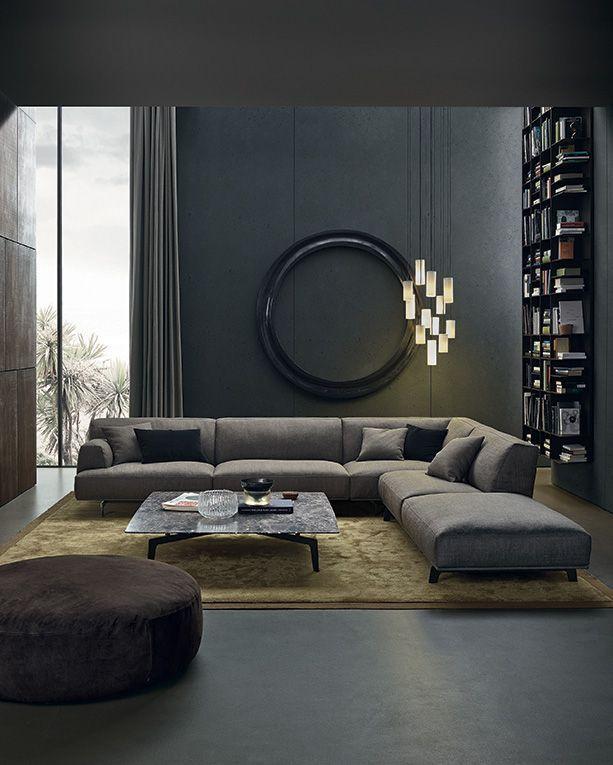 En la imagen un salón contemporáneo, en un tono gris con mucho carácter.