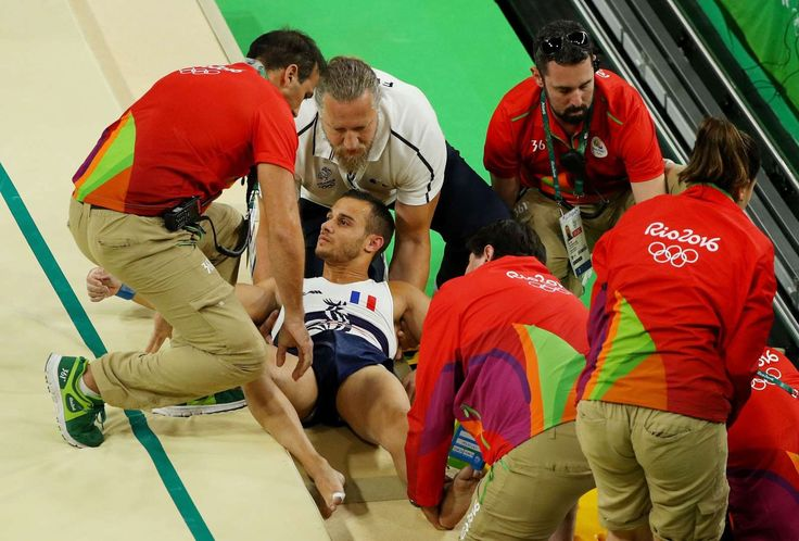 Bad break:    Samir Ait Said of France receives medical attention after breaking his leg while competing on the vault during the artistic gymnastics men's team qualification on Aug. 6.