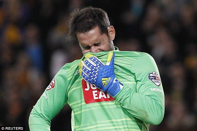 Derby County goalkeeper Scott Carson looked distraught when the full-time whistle was blown and Hull had squeezed through to the Championship play-off final 3-2 on aggregate