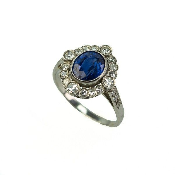 Platinum engagement ring with diamonds and a sapphire