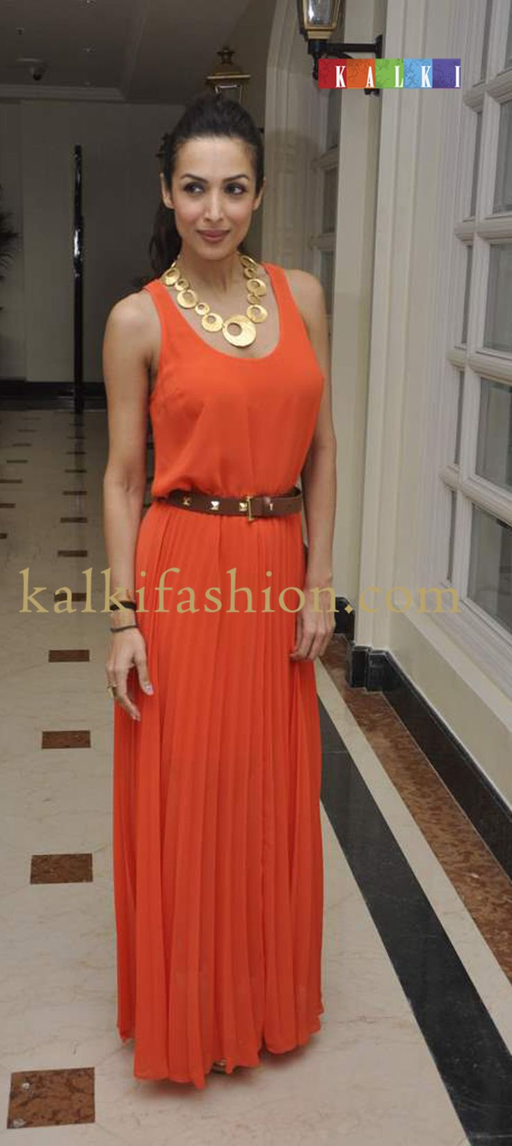 http://www.kalkifashion.com/    malika Arora Khan in an orange maxi by Michael Kros at at Australia Film Festival.