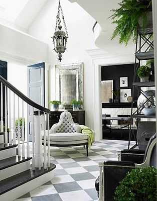 . Like use of grey with black and white. Very elegant, streamlined and yet youthful bolts of color and painted floor.