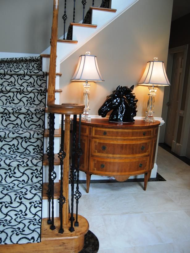 10 Runway-Ready Carpeted Staircases: A bold patterned carpet runner can add visual interest to a neutral space. Design by Paisley McDonald From DIYnetwork.com