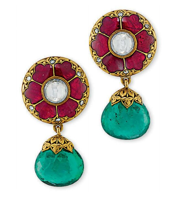 EMERALD DIAMOND AND CORUNDUM EAR PENDANTS Each mounted with a rose-cut diamond collet and six red foiled corundum panels of Indian design with rose-cut diamond detail to the circular engraved surmount of foliate motif suspending a similarly engraved cap and a briolette-cut emerald drop, 3.5cm long