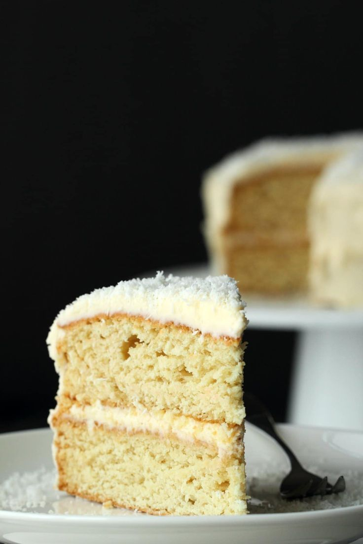 Fabulously Coconutty Two Layered Vegan Coconut Cake Topped With A Decadent Coconut Rum Frosting Super Easy Vegan Cake Recipes Coconut Baking Vegan Lemon Cake