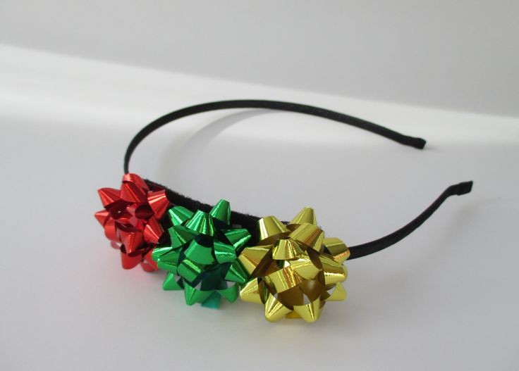 Adorable Christmas Bows Headband. Quality item. Hand made. The band itself is made out of sturdy metal stamping than wrapped with matching satin ribbon. Assembled in USA