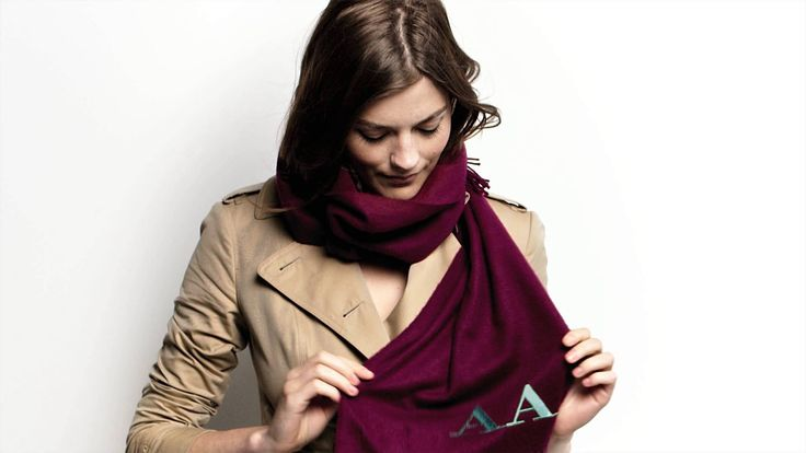 Model Amber Anderson demonstrates how to tie a scarf in The Bandana style in under 30 seconds. The Bandana step by step: Step 1: Begin by draping the scarf a...