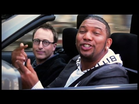 Jon Ronson: Tuesday Music Video - Escape and Control: Remember the internet uber hit 'Friday' featuring Rebecca Black? The   video racked up more than 167 million views and in the final episode of   Escape and Control, Jon Ronson visits the songs' producer Patrice   Wilson.  Together they make what Patrice thinks will be a new hit record   featuring Jon himself!  Why not have a look and see what you think?