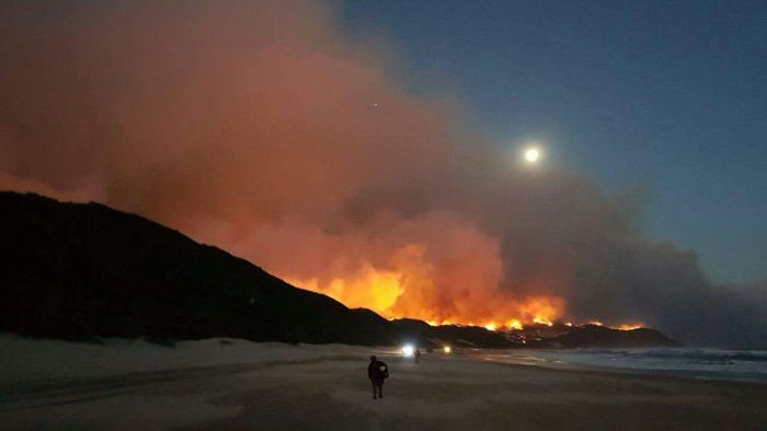 The seaside town is under threat as an estimated 26 runaway fires blaze their way across this section of the famed Garden Route.