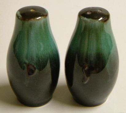 """Blue Mountain Pottery was a Canadian pottery company located in Collingwood, Ontario. It was founded in 1947 by Jozo Wieder and closed in 2004.  items feature a unique, trademarked glazing process known as """"reflowing decorating."""" Two different liquid glazes, one light and one dark in color, were applied. During the firing process the glazes would run, creating streaking patterns unique to each piece."""