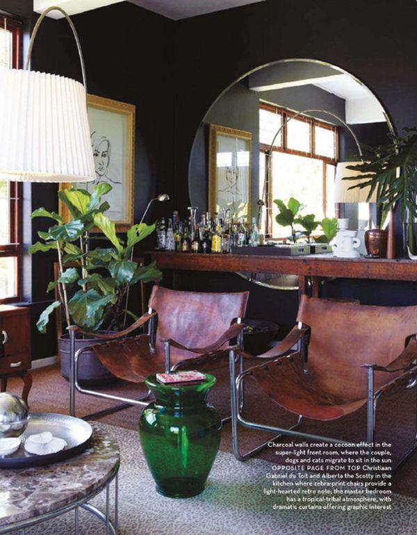 dark walls, round mirror, leather chairs, masculine glam