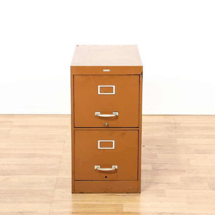 """This """"Cole"""" file cabinet is featured in a shiny, polished burnt orange steel. This traditional chest of drawers has bright white handle pulls, simple straight sides, and 2 spacious drawers. Perfect for organizing paperwork! #americantraditional #storage #filecabinet #sandiegovintage #vintagefurniture"""