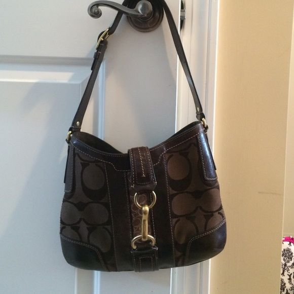 """MAKE AN OFFER! Coach brown leather buckle bag Gently used Coach brown leather buckle bag. Has small markings on the bottom of the bag but really unnoticeable. Beautiful leather bag. Approximately 7.5"""" wide by 9"""" tall. Authentic bag Coach Bags Shoulder Bags"""