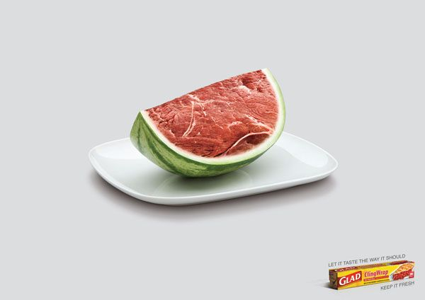 Glad® ClingWrap grips tight, seals easily and protect the food you love, helping to keep it fresher, longer. It's easy to handle, microwave‐safe and contains no plasticizers, so you can reheat with confidence.  The main idea of the product is to assist consumer in maintaining freshness of food. The ad depicts watermelon with its flesh of a meat. The freshness of the meat is retained as its best condition by metaphorically using the watermelon as the key level of freshness.