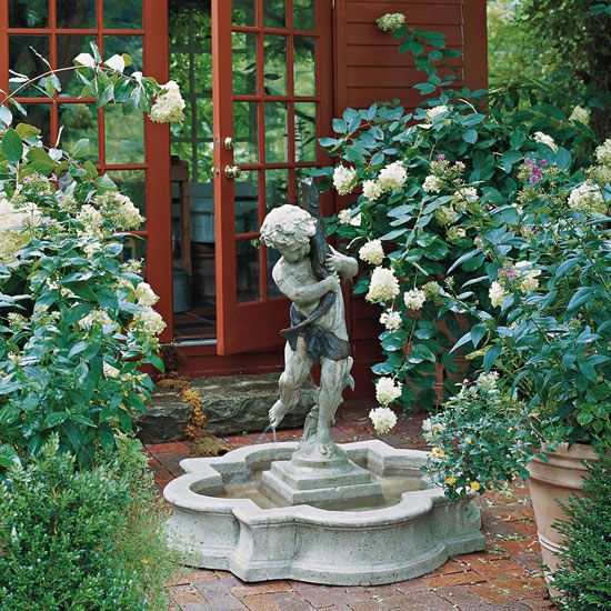 Add character to the landscape by surrounding the fountain with blooming plants and lush greenery: http://www.bhg.com/gardening/landscaping-projects/water-gardens/outdoor-fountain-ideas/?socsrc=bhgpin032714statuefountains&page=9