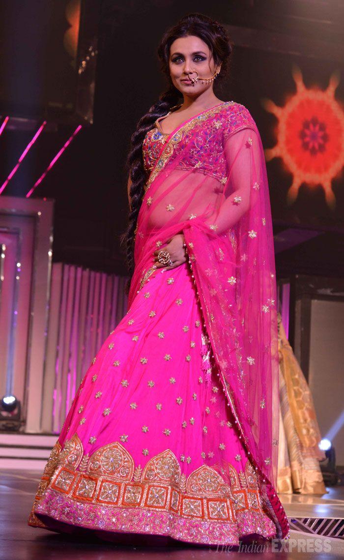 Rani Mukherji in a fuchsia pink lehenga celebrating late film maker Yash Chopra's 81st birthday Sept 27, 2013 at Yash Raj Studio recalling her Pakistani lawyer character in his film Veer-Zaara