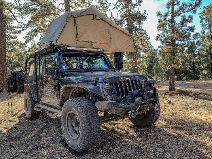 Jeep and Tuff stuff overland rooftop tent. Overland