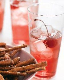 Pomegranate Soda    (1 cup sugar  1/2 cup pomegranate juice  Club soda, for serving  Maraschino cherries, for garnish)