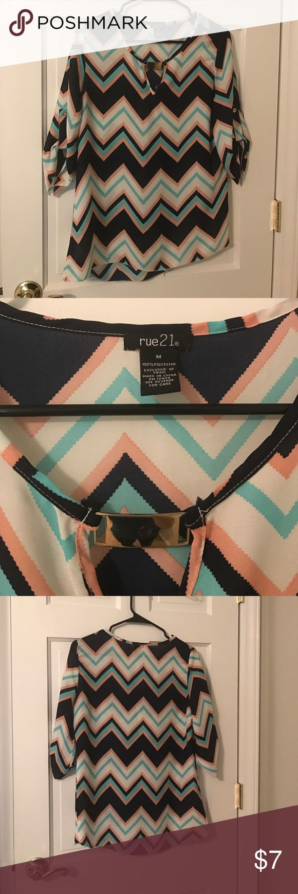 Rue 21 chevron top Chevron top from Rue 21.  3/4 sleeves with gold accent on the front, gold buttons on the sleeves.  Super cute with leggings and for the office!  Colors are navy blue, coral, real and white. Rue 21 Tops Blouses