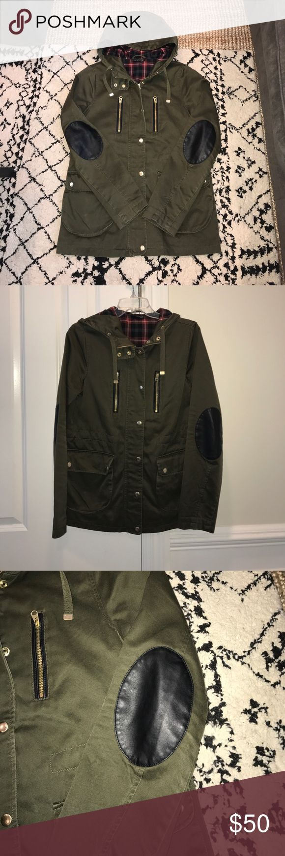 Topshop Elbow Patch Jacket Perfect for spring! Lightweight olive jacket with zip front, gold snap closures, Plaid-lined hood and faux leather elbow patches. 2 zip pockets on body and two larger snap closure pockets at waist. Worn once. Like new condition. Topshop Jackets & Coats Utility Jackets