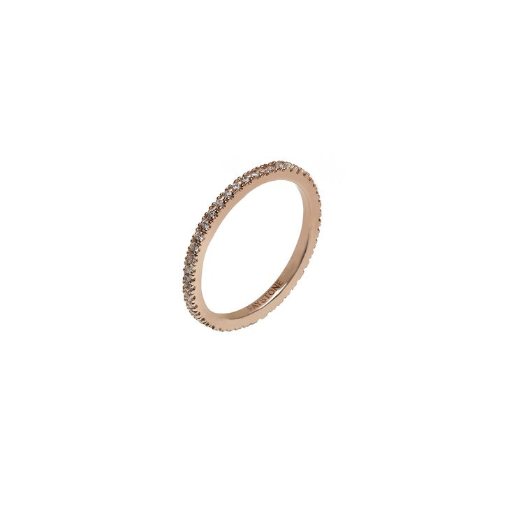 A chic 18K rose gold band composed of sparkling brilliant cut diamonds, the Carina Rose gold ring is inspired by the stars that shine bright like diamonds in the sky.