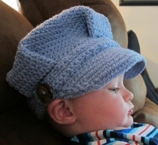 Train conductor hat.  Pattern by Micah York