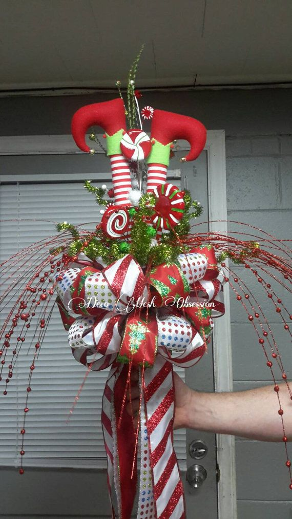 Check out this item in my Etsy shop https://www.etsy.com/listing/256415902/elf-legs-christmas-tree-topper-ready-to