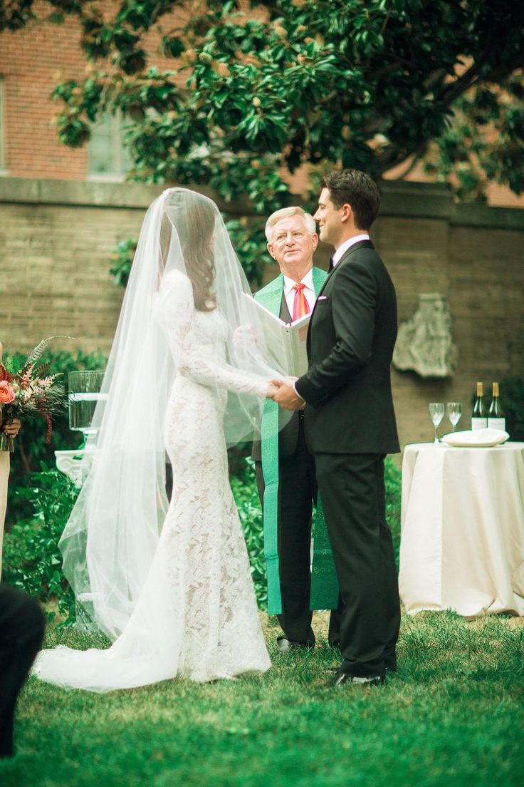 GORGEOUS, veil over face,UNTIL the husband kisses her.Awww