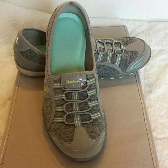 Womens Sketchers memory foam slip on tennis shoes Womens size 9 Sketchers tennis shoes. These have memory foam in them so they are super comfy and slip on. Very cute with the grey and blue colors! Only worn a couple times so in great condition!! Skechers Shoes Athletic Shoes