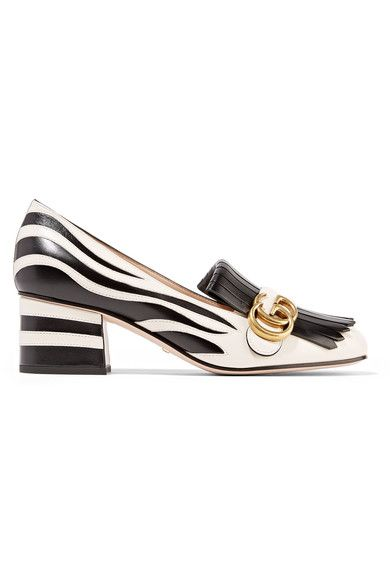 Gucci's cult pumps are updated with a playful zebra pattern for Fall '16 - they're the perfect way to inject pattern and individuality into your look. Crafted from leather in a loafer-inspired silhouette, this pair is detailed with soft fringing and the house's signature 'GG' plaque. Keep them in focus with cropped pants or jeans.