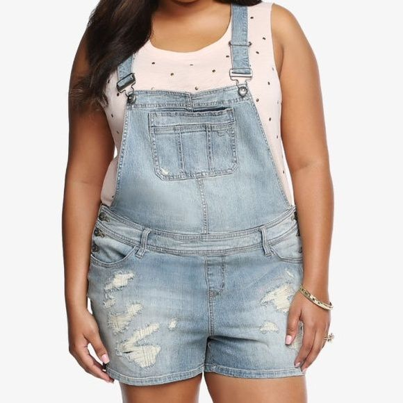 "Torrid Premium Denim Overall Shorts Plus Size 16 Brand New With Tags Plus Size 16 Retails $68.50  This is what weekends are made of - a totally relaxed and chill vibe. These denim overall shorts are the perfect weekender look. They have a light wash that gives them a well-worn feel. Ripped and repaired destruction adds a trendy look to this hand-sanded style. It's finished with a crisscross back and light whiskering.  3 1/2"" inseam 98% cotton; 2% spandex torrid Other"