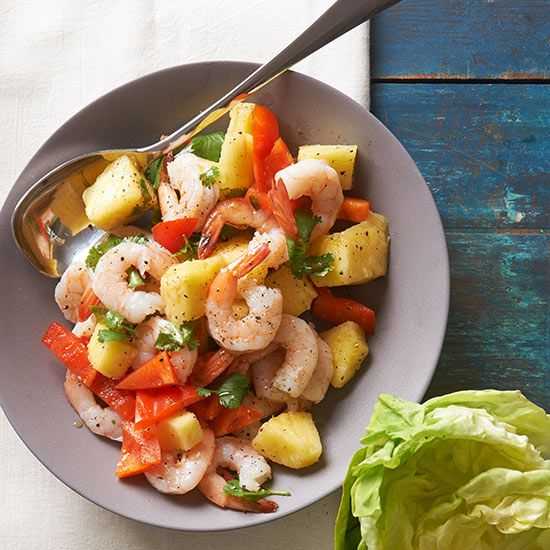 Need a no-cook dish that sings with flavor? Look no further! Tender shrimp and toasty sesame seed oil provide savory depth, and fresh pineapple and peppers add crunchy sweetness. Wrap it all in buttery lettuce for a meal to remember. /
