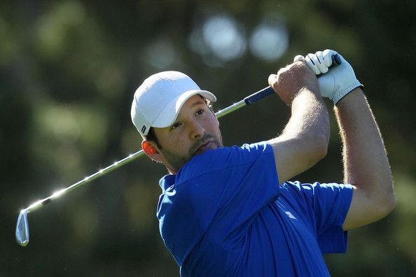 Tony Romo Photos Photos - American football player Tony Romo hits a tee shot on the 12th hole during the AT&T Pebble Beach National Pro-Am at the Spyglass Hill Golf on February 9, 2012 in Pebble Beach, California. - AT&T Pebble Beach National Pro-Am - Round One