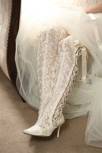 Lace OTK boots, tied oh-so-prettily with double-sided satin ribbon.  Strictly for the bride who walks to the beat of her own drum. #wedding #shoes