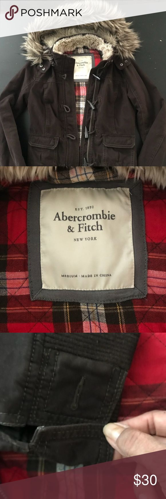 Abercrombie and Fitch Hooded Jacket Great for cold weather but not super thick. Beautiful fur hood looks great on! Missing one button on the wrist, see photo. Abercrombie & Fitch Jackets & Coats