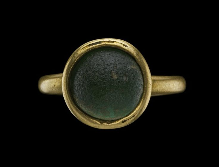 Finger-ring; gold; with convex green glass set into a rimmed bowl bezel; tapered hoop is butt-soldered to the edge of the bowl. Culture/periodEarly Byzantine term details Date7thC Materialsgold term detailsglass term details