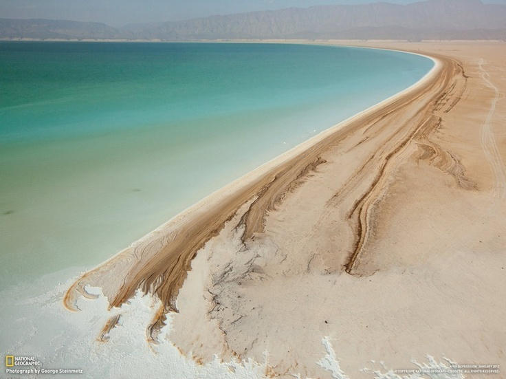 Djibouti's Lake Assal is one of the world's saltiest lakes. Intense heat and strong winds fuel rapid evaporation, leaving a bathtub ring of minerals around the lake's shore.