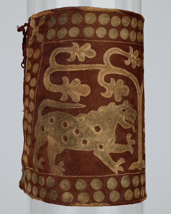 5th cent embroidered silk armband of lions under tree. Confirmed that it's Sassanian