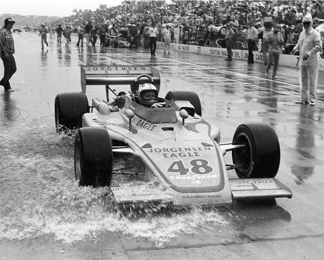 Indy 500, 1975: Winner Bobby Unser drives through the pits after a downpour ends the race. Johnny Rutherford was closing on Unser, and A.J. Foyt was catching them both when the skies opened up.